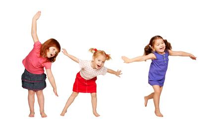Happy little children dancing. Joyful party.