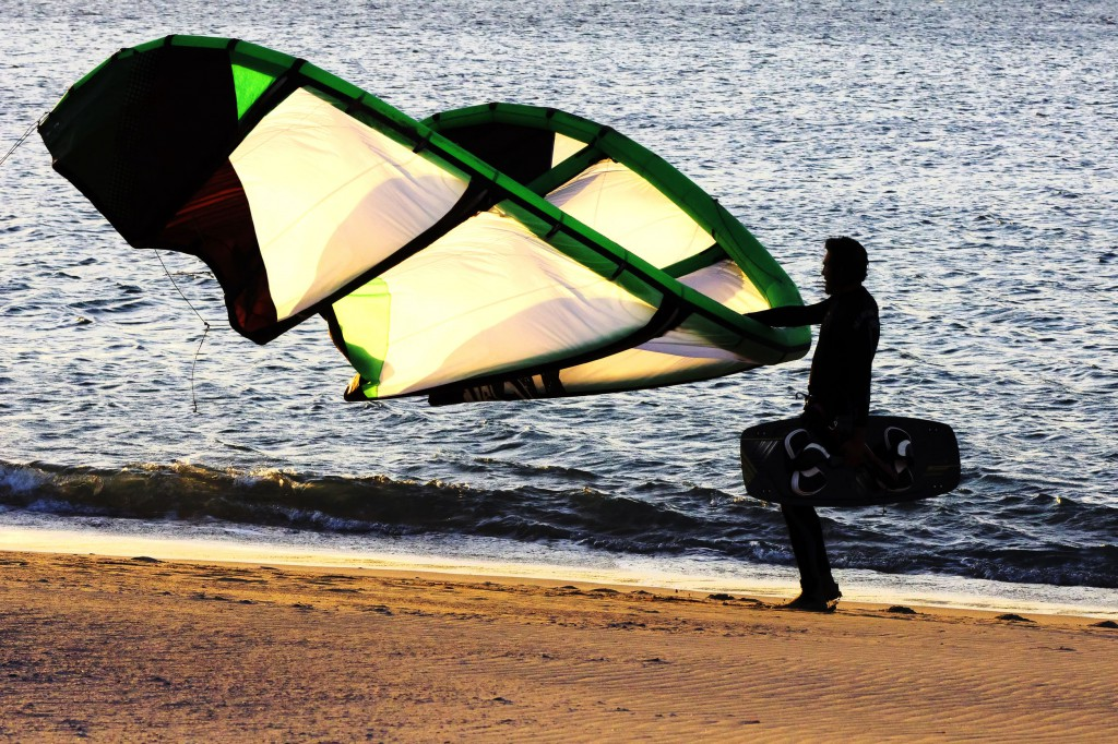 40825094 - backlight kitesurfing on the beach at sunset in sabon atlantic beach