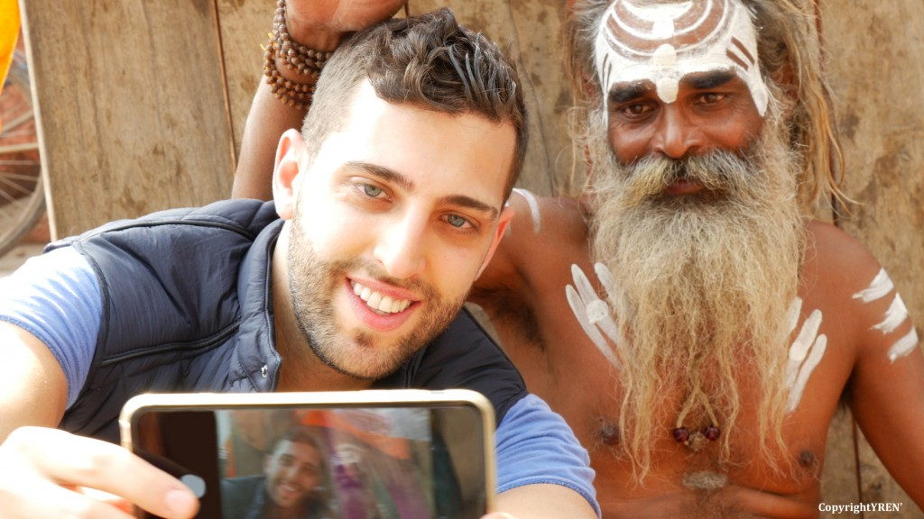 Tourist taking a selfie with Sadhu - Holy Man, in Varanasi, Indi