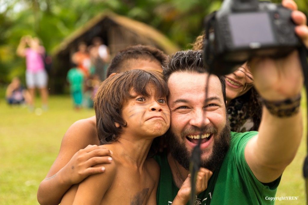 Brazilian tourists taking selfie photos with Brazilian Natives (