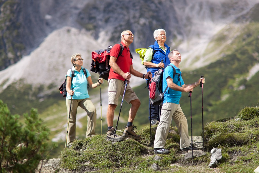 four senior hikers on sunny day
