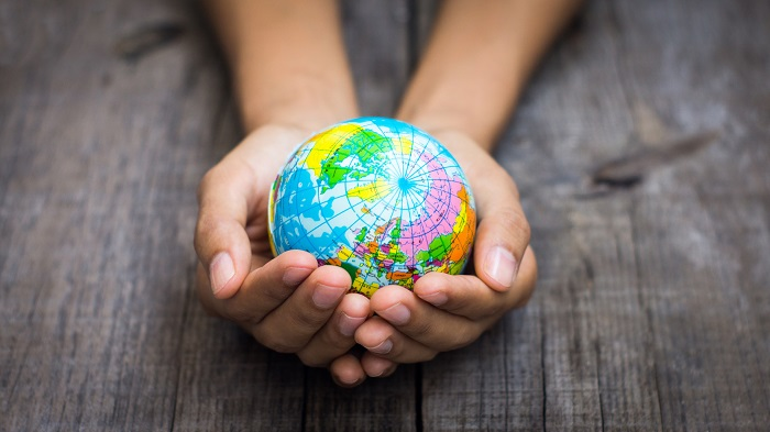 Person holding a globe