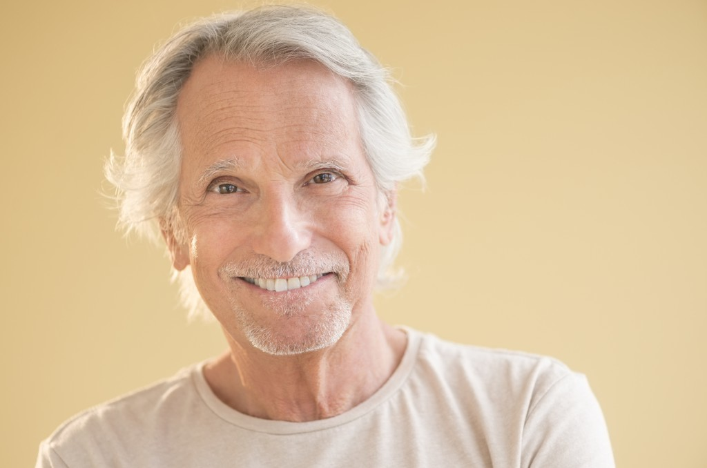http://www.dreamstime.com/stock-photography-portrait-happy-senior-man-isolated-over-beige-background-image32482102