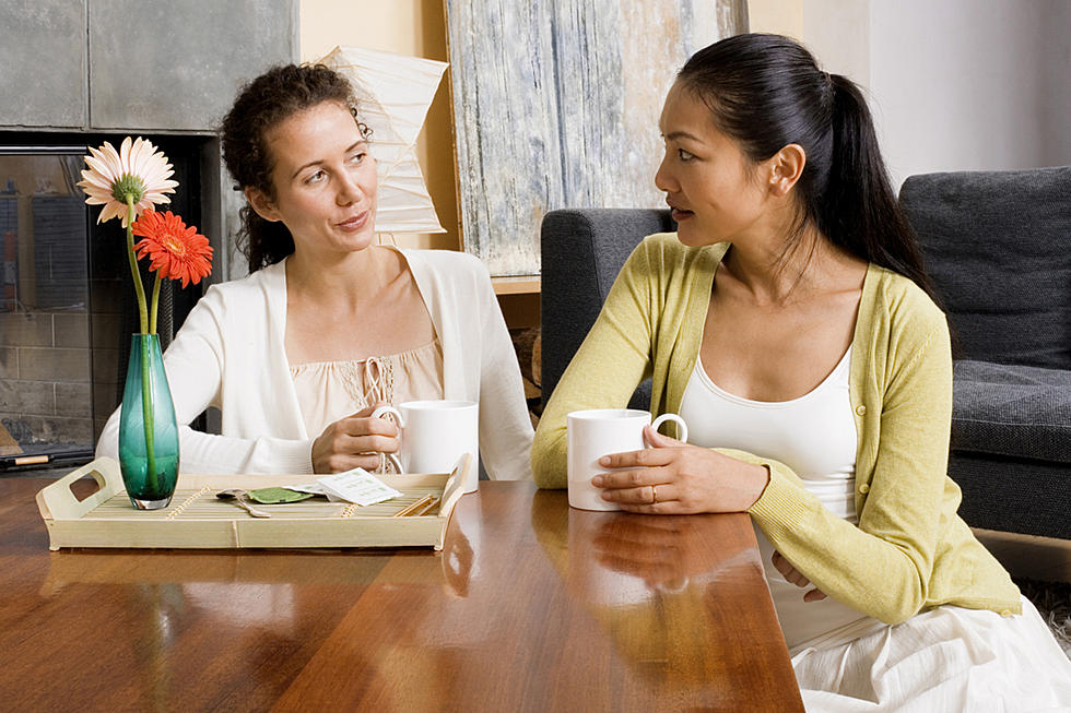 women-talking-over-coffee