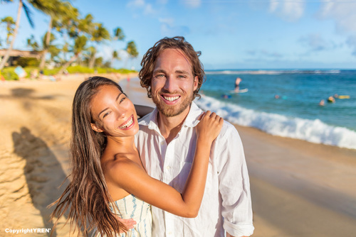 Couple in love hugging happy together on beach travel holidays a