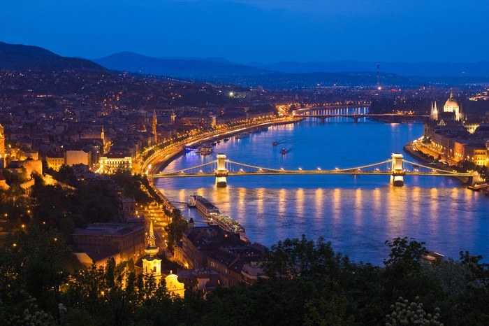 a view of Budapest, Hungary with the Chain Bridge in the forefro