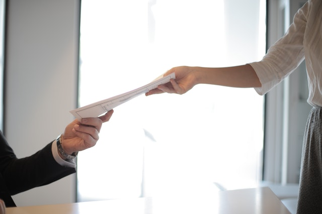 job-applicant-passing-her-documents-3760072